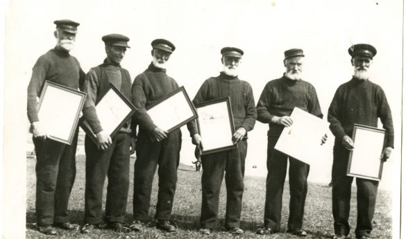 Photograph of Lifeboat crew with certificates