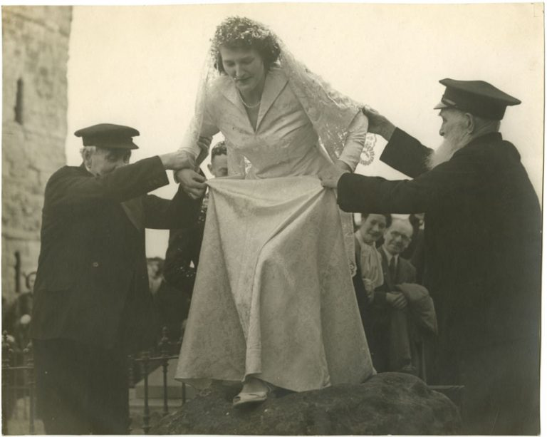 Black and white photographs of the wedding of Colin Teago to Margaret Penelope Allison of Holy Island and a written introduction