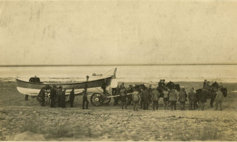 Photographs of Holy Island Lifeboat crew and stations and an RNLI Programme