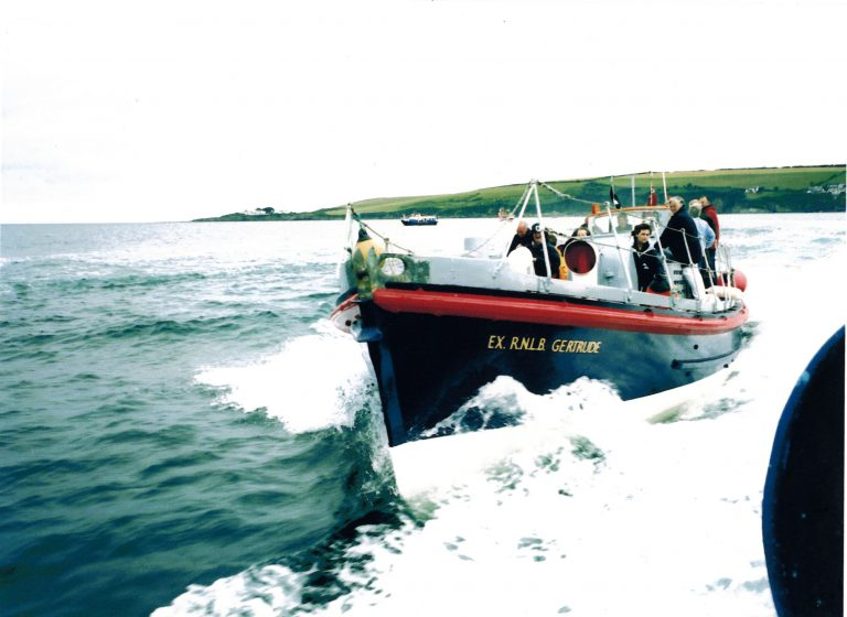 Letter and 9 photographs re: Holy Island Lifeboat