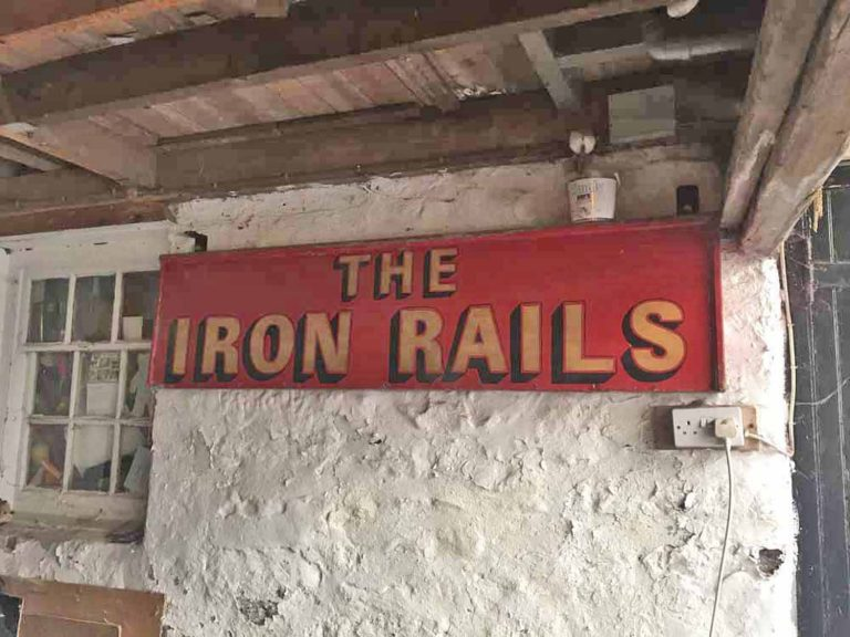 Photograph of the old Iron Rails pub sign (HOL 034/002)